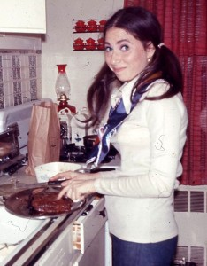 Madeleine, in her early 20s, cooking in her kitchen